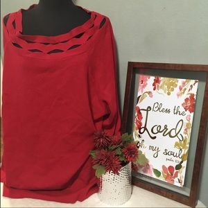 Red sweater with diamond cuts
